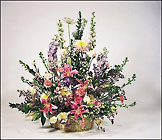 floral garden arrangement in wicker basket